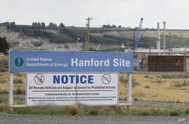 FILE - A sign informs visitors of prohibited items on the Hanford Nuclear Reservation near Richland, Wash. A new report says Congress should consider authorizing the Department of Energy to use grout to stabilize some of Hanford's radioactive waste,