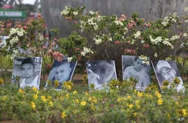 Photos of the dead are displayed in a roundabout In Managua, Nicaragua, April 24, 2018. Human rights groups say clashes between police and protesters left nearly 30 dead since people have protested proposed tax hikes and benefit cuts to shore up the ...