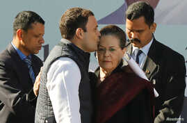 Rahul Gandhi, newly elected president of India's main opposition Congress Party, kisses the forehead of his mother and leader of the party, Sonia Gandhi, after taking charge as the president during a ceremony at the party's headquarters in New Delhi,...