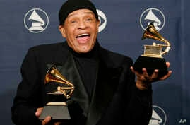 """FILE - In this Sunday, Feb. 11, 2007, file photo, Al Jarreau poses with his awards for best pop instrumental performance for """"Mornin'"""" and best traditional R&B vocal performance for """"God Bless the Child"""" at the 49th Annual Grammy Awards in Los Angele"""