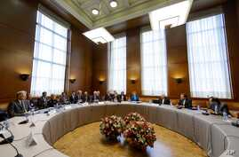 General view prior to the start of the two days of closed-door nuclear talks on Tuesday,  Oct. 15, 2013 at the United Nations offices in Geneva, Switzerland. Iran's overtures to the West are being tested as the U.S. and its partners sit down for the