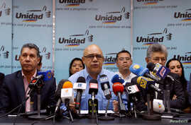 Jesus Torrealba (C), secretary of Venezuela's coalition of opposition parties (MUD), Henry Ramos Allup (R), President of the National Assembly and Henri Falcon, governor of Lara, talk during a news conference to demand a referendum to remove Presiden