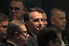 Brazil's President Jair Bolsonaro arrives at the inauguration ceremony of the new president of the Parliamentary Front of Agriculture (FPA), at the Clube Naval, in Brasilia, Jan. 19, 2019.