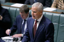 FILE - Australian Nationals party leader and Deputy Prime Minister Michael McCormack makes a speech in parliament in Canberra, Monday, Feb. 26, 2018. McCormack was appointed after his predecessor quit over a sexual harassment allegation.