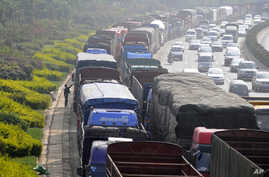 Vehicles line up for diesel near a gas station in Kunming, Yunnan province, China. Controlling soot from trucks, cars, planes, boats and wood and dung fires can have an immediate impact on climate change.