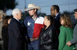 Vice President Mike Pence and his wife, Karen, talk with Johnnie Langendorff, and his girlfriend Summer Caddell, third from right, as they visit with first responders, family, friends and victims outside the Sutherland Spring Baptist Church, Nov. 8, ...