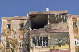 Destruction caused by a rocked fired from Gaza in an apartment building in Kiryat Malachi, southern Israel.