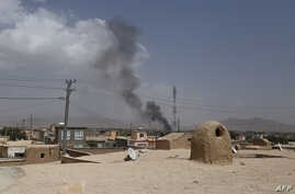 Smoke rises into the air after Taliban militants launched an attack on the Afghan provincial capital of Ghazni, Aug. 10, 2018.