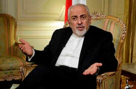 Iran's Foreign Minister Mohammad Javad Zarif is interviewed by The Associated Press, in New York, Tuesday, April 24, 2018. Zarif is warning the Trump administration that pulling out from the Iran nuclear deal would undermine talks with North Korea by