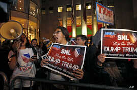 """Protesters opposed to the appearance of Republican presidential candidate Donald Trump's appearance as a guest host on """"Saturday Night Live,"""" shout anti-Trump slogans as they demonstrate in front of NBC Studios where the show is taped and broadcast,"""