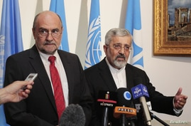 International Atomic Energy Agency chief inspector Herman Nackaerts (L) and Iran's IAEA ambassador Ali Asghar Soltanieh brief the media after a meeting at the Iranian embassy in Vienna, August 24, 2012.