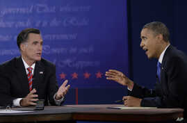 President Barack Obama, right, and Republican presidential nominee Mitt Romney discuss a point during the third presidential debate at Lynn University in Boca Raton, Florida, October 22, 2012.