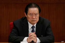 FILE - Zhou Yongkang, then Chinese Communist Party Politburo Standing Committee member in charge of security, attends a plenary session of the National People's Congress at the Great Hall of the People in Beijing, China.