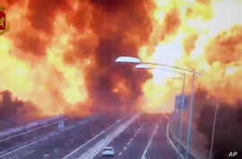 In this frame grab taken from a video released by the Italian police, the moment a truck that was transporting flammable substances explodes after colliding with another truck on a highway on the outskirts of Bologna, Aug. 6, 2018.