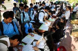 Students register to participate in a campaign by the National Election Committee, NEC, in Phnom Penh, Cambodia, May 9, 2018.