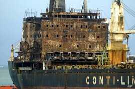 The MV Pacific Express which was set on fire by suspected Somali pirates on September 21, 2011 is towed along the Likoni channel by Kenya Ports Authority tug boats to the port of Mombasa, Kenya. (File Photo - September 30, 2011)