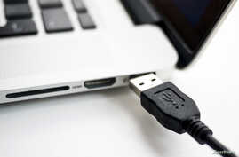 FILE - USB devices such as mice, keyboards and thumb-drives can be used to hack into personal and public computers.