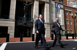 Kevin Downing, left, and Thomas Zehnle, with the defense team for Paul Manafort, leave federal court during the second day of jury deliberations in the trial of the former Trump campaign chairman, in Alexandria, Va., Aug. 17, 2018.