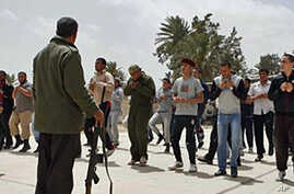 Pro-Government Shelling in Libya Delays Relief Mission
