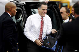 Republican presidential candidate Mitt Romney gets out of his vehicle before boarding his campaign plane at Toledo Express Airport in Toledo, Ohio, Oct. 26, 2012.