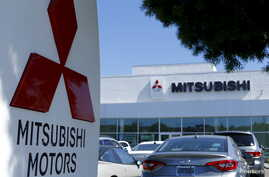 FILE - A Mitsubishi Motors dealership is shown in Poway, California, July 27, 2015.