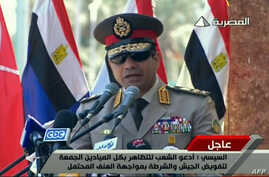 "FILE - An image grab taken from Egyptian state TV shows Egypt's army chief General Abdel Fattah al-Sisi giving a live broadcast calling for public rallies this week to give him a mandate to fight ""terrorism and violence,"" as Mohamed Morsi's supporter"
