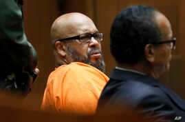 """Former rap mogul Marion """"Suge"""" Knight, left, with his defense attorney Albert DeBlanc Jr., listens to the terms of his plea of no contest to voluntary manslaughter in Los Angeles Superior Court, Sept. 20, 2018."""