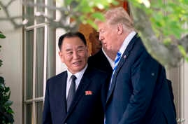 President Donald Trump talks with Kim Yong Chol, former North Korean military intelligence chief and one of leader Kim Jong Un's closest aides, as they walk from their meeting in the Oval Office of the White House in Washington, June 1, 2018.