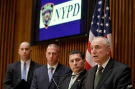 New York Police Commissioner Bill Bratton (R) speaks during a news conference at police headquarters, Feb. 25, 2015, in New York, regarding three men who were arrested on charges of plotting to travel to Syria to join the Islamic State group and wage