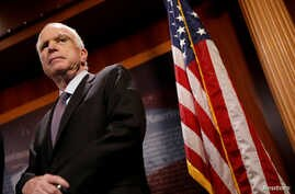 """FILE - Senator John McCain (R-Az.) looks on during a press conference about his resistance to the so-called """"Skinny Repeal"""" of the Affordable Care Act on Capitol Hill in Washington, July 27, 2017."""
