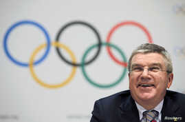 FILE - International Olympic Committee President Thomas Bach appears at a news conference in Monaco at which the organization unveiled its timeline for candidates for the 2024 Summer Games, Dec. 6, 2014.