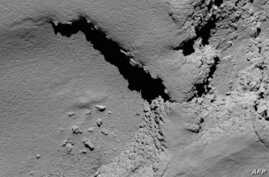 A handout picture released on Sept. 30, 2016 by the European Space Agency (ESA) shows a view taken by Rosetta's OSIRIS narrow-angle camera of Comet 67P/Churyumov-Gerasimenko at 08:18 GMT from an altitude of about 5,8 km during the spacecraft's final