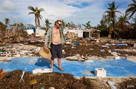 "Billy ""The Kid"" Quinn, 48, assesses the damage atop a blue slab where his home used to be in Islamorada's Seabreeze Trailer Park. (R. Taylor/VOA)"
