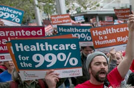 FILE - Supporters of single-payer health care march to the Capitol in Sacramento, Calif., April 26, 2017.