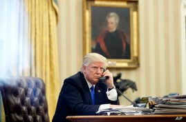 FILE - President Donald Trump speaks on the phone in the Oval Office of the White House  in Washington, Jan. 28, 2017. Desperate for a legislative victory, Trump is upping the pressure on lawmakers to act on several initiatives.