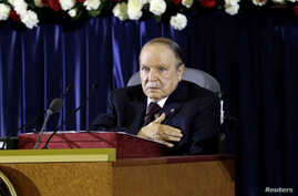 President Abdelaziz Bouteflika gestures during a swearing-in ceremony in Algiers, April 28, 2014.