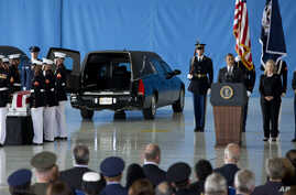 President Barack Obama, accompanied by Secretary of State Hillary Clinton, speaks during the Transfer of Remains Ceremony, September 14, 2012, at Andrews Air Force Base, Maryland, marking the return to the United States of the remains of the four Ame