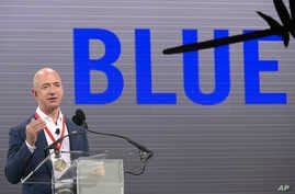 Amazon CEO Jeff Bezos addresses reporters and guests during a news conference unveiling the new Blue Origin rocket at the Cape Canaveral Air Force Station in Cape Canaveral, Fla., Sept. 15, 2015.