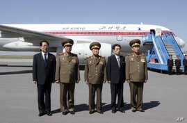 Choe Ryong Hae, dir. of the General Political Bureau of the Korean People's Army (KPA) (C). From left, Kim Hyong Jun, deputy minister Foreign Affairs, Ri Yong Gil, Col. Gen.of KPA, Kim Song Nam, vice dept. dir. of Central Committee of the Workers par