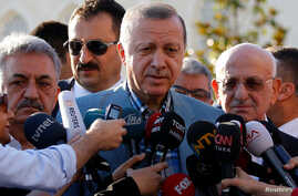 Turkey's President Tayyip Erdogan talks to media after the Eid al-Fitr prayers in Istanbul, June 25, 2017.