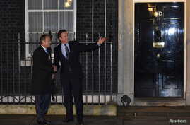 British Prime Minister David Cameron (R) and European Council President Donald Tusk are seen on the steps of Downing Street in London, Britain, Jan. 31, 2016.