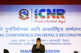 Nepal's Prime Minister Sushil Koirala greets upon his arrival to take part in the International Conference of Nepal Reconstruction in Kathmandu, June 25, 2015.