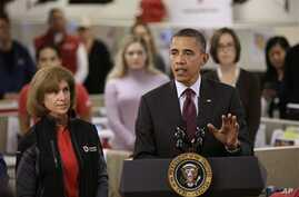 President Barack Obama, accompanied by American Red Cross President and CEO Gail J. McGovern, gestures while speaking during his visit to discuss superstorm Sandy, at the Disaster Operation Center of the Red Cross National Headquarters in Washington,