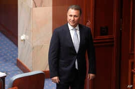 FILE - In this Oct. 19, 2018 file photo, Nikola Gruevski, the country's former Prime Minister, looks in on the Macedonian Parliament in the capital Skopje.