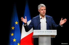 """Laurent Wauquiez, the front-runner for the leadership of French conservative """"Les Republicains"""" party attends a political rally in Saint-Priest, near Lyon, France, Dec. 7, 2017."""