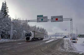 A truck passes the Norwegian border towards Sweden, Feb. 8 2019. Norway's hard border with the European Union is equipped with cameras, license-plate recognition systems and barriers directing traffic to Customs officers.