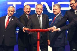 Turkey's President Recep Tayyip Erdogan, centre, attends the opening ceremony of Trans-Anatolian Natural Gas Pipeline (TANAP), a key pipeline that will carry natural gas from Azerbaijan's gas fields to Turkish markets and eventually to Europe, in Esk