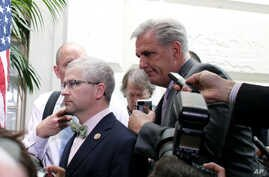 House Majority Leader Kevin McCarthy of Calif., right, and Rep. Patrick McHenry, R-NC, left, race past reporters on Capitol Hill, Washington, Sept. 25, 2015.