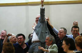 Fianna Fail's Declan Breathnach celebrates after being elected during the second day of the General Election count in Dundalk, Ireland, Feb. 28, 2016.