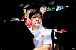 "Vice presidential candidate Sen. Ferdinand ""Bongbong"" Marcos Jr. talks to the media during his campaign sortie in Muntinlupa city, southeast of Manila, Philippines, Feb. 22, 2016."